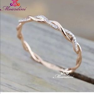 14kt rose gold plated twisted cz ring